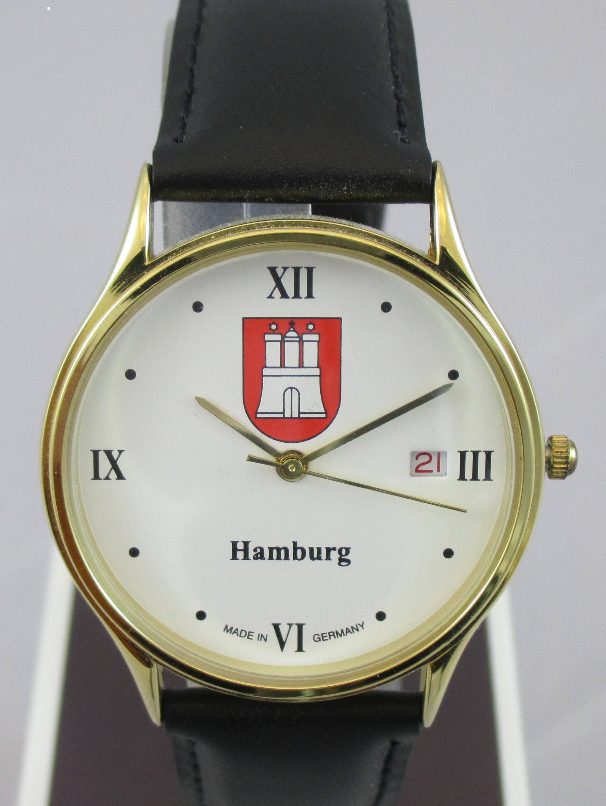 Herrenuhr vergoldet mit Datum